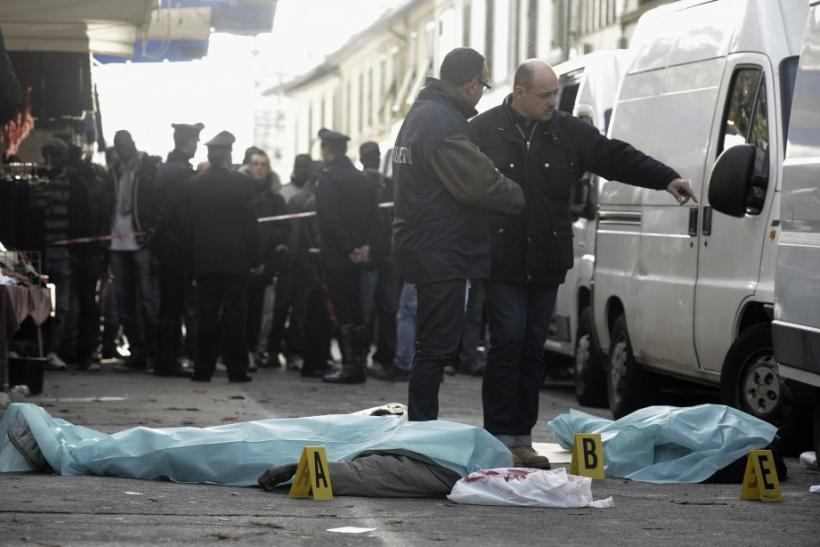Two Senegalese vendors lie dead on the ground in downtown Florence