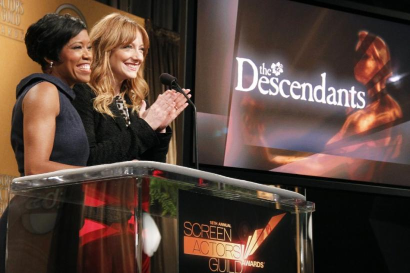 "Actress Judy Greer (R) reacts as she and Regina King (L) announce ""The Descendants"" as a motion picture nominee for the 18th Annual Screen Actors Guild Awards in West Hollywood, California"