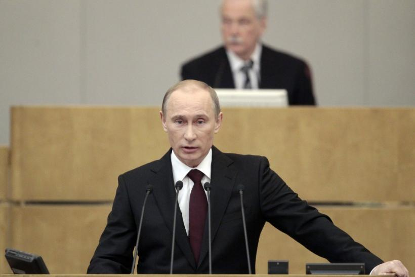 Russia's Prime Minister Vladimir Putin addresses the parliament, with Parliament Speaker and Chairman of the United Russia political party council Boris Gryzlov in the background, at Russian State Duma in Moscow