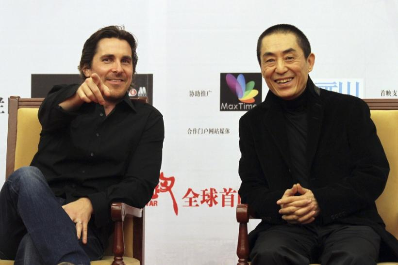 "British actor Bale and Chinese director Zhang attend the premiere of ""The Flowers of War"" in Beijing"
