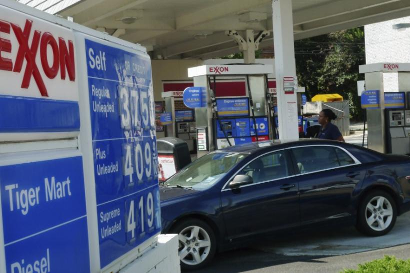A motorist fills up her tank with gas at an Exxon gas station in Arlington