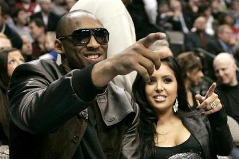 Los Angeles Lakers' Kobe Bryant (L) and his wife Vanessa attend activities during the NBA All-Star weekend in Dallas, Texas