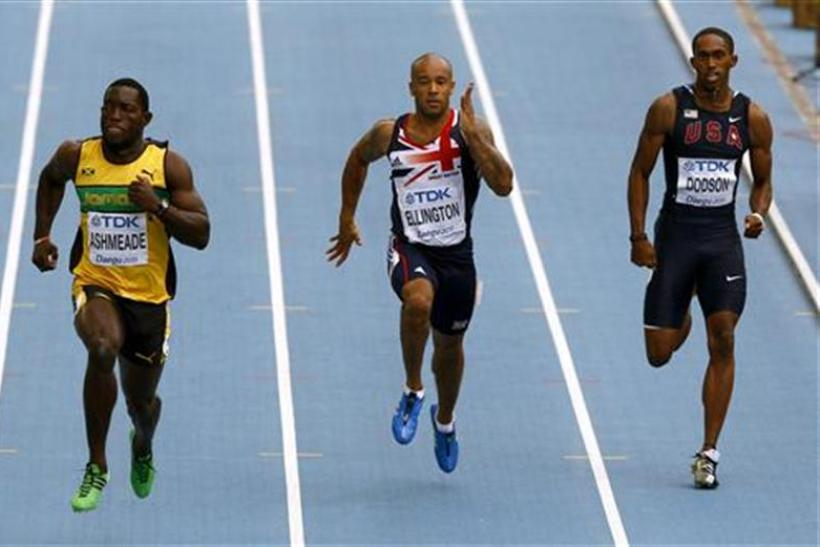 James Ellington of Britain runs next to Nickel Ashmeade of Jamaica and Jeremy Dodson of the U.S. in Daegu