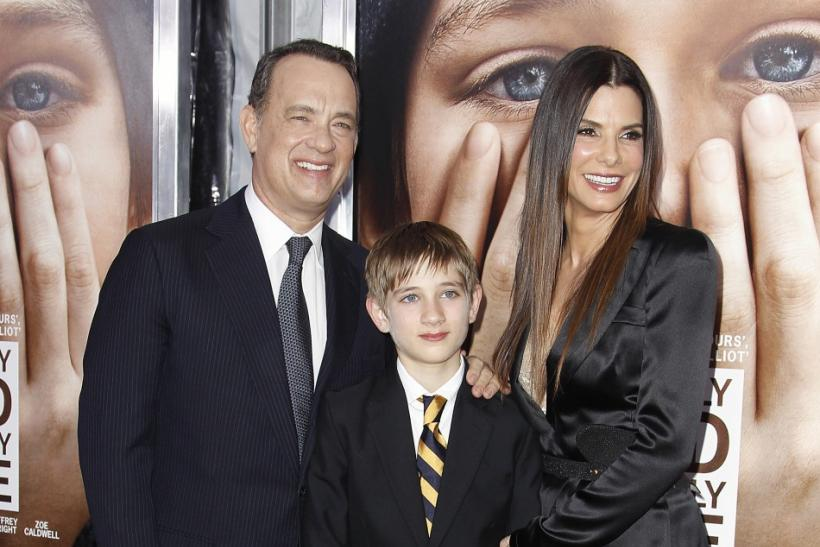 "Cast members Tom Hanks (L), Thomas Horn (C) and Sandra Bullock arrive for the premiere of the film ""Extremely Loud and Incredibly Close"" in New York"