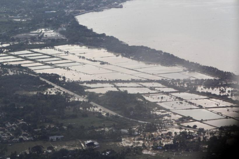 An aerial view shows villages inundated in floodwaters caused by typhoon Washi in Cagayan de Oro, southern Philippines