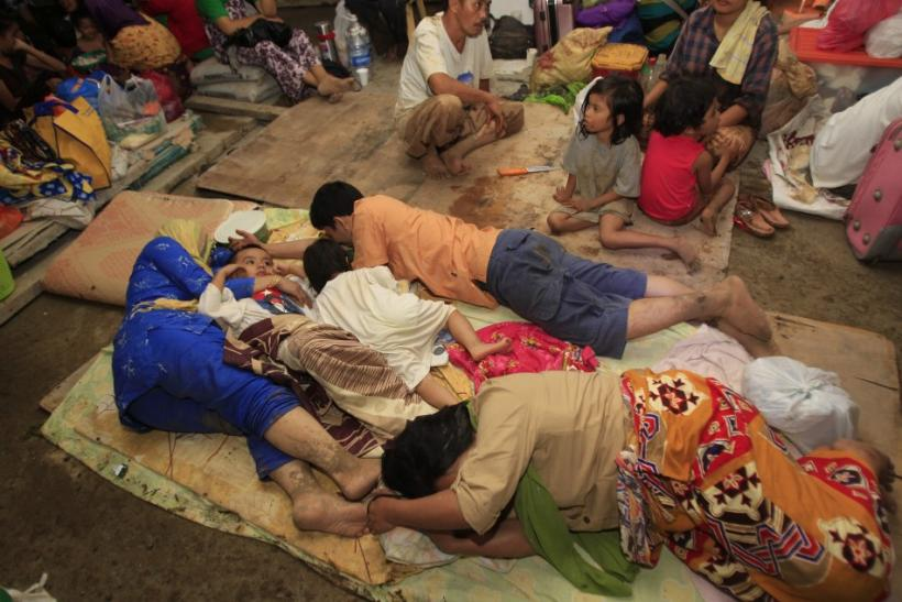 Residents rest in an evacuation centre after their houses were washed away by flashfloods caused by typhoon Washi in Cagayan de Oro, southern Philippines