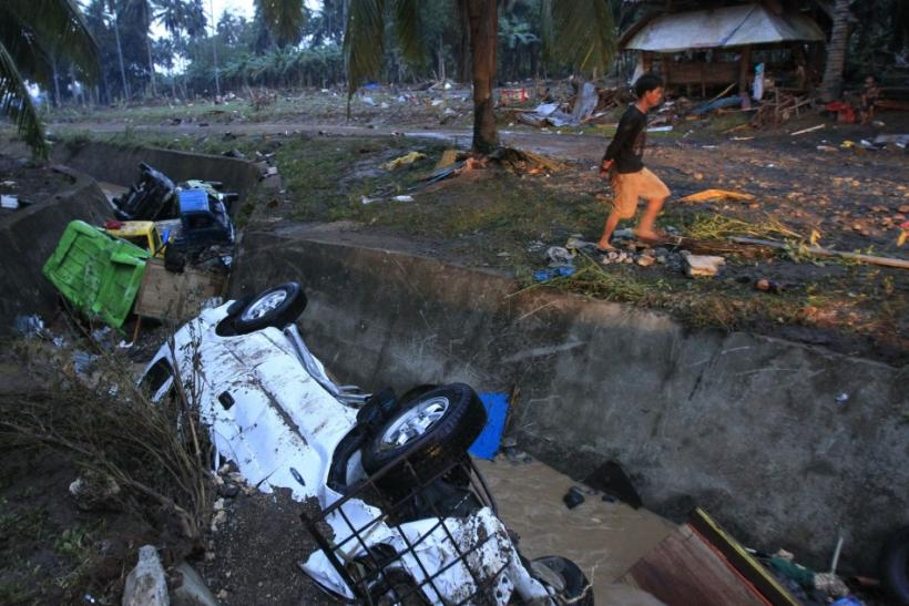 Damaged vehicles swept away by flashfloods caused by typhoon Washi lie in a ditch in Balulang village in Cagayan de Oro, southern Philippines