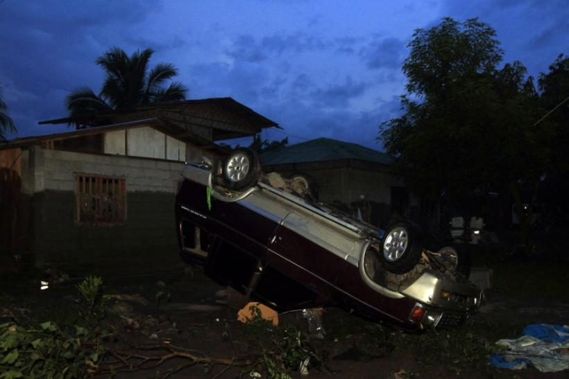 A vehicle washed away by flashfloods caused by typhoon Washi lies outside down in Balulang village in Cagayan de Oro in southern Philippines
