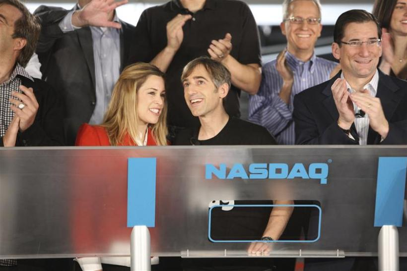 Publicity photo of Zynga CEo Mark Pincus and wife Ali following the ringing of the opening bell for the NASDAQ exchange in San Francisco