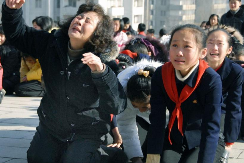Pyongyang residents react as they mourn over the death of North Korean leader Kim Jong-il in Pyongyang, in this photo taken by Kyodo