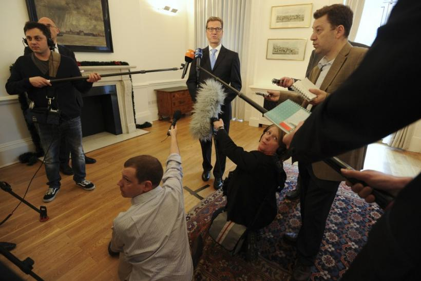 German Foreign Minister Guido Westerwelle speaks to members of the media at the German Embassy in London