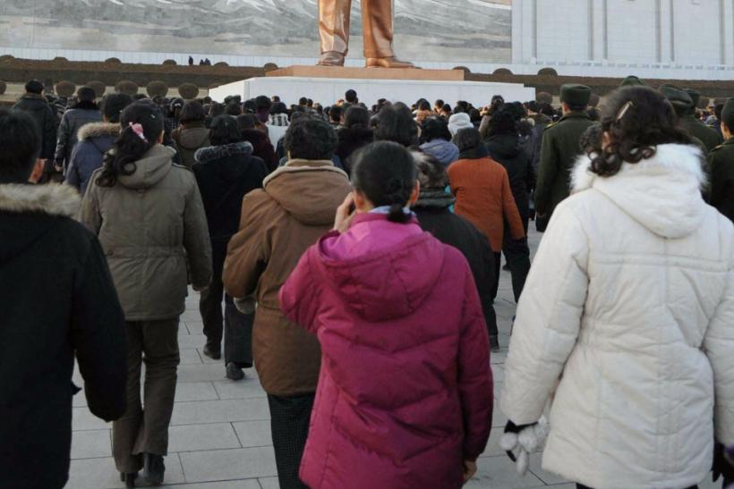 Pyongyang residents mourn the death of North Korean leader Kim Jong-il at a square on Mansu Hill in Pyongyang