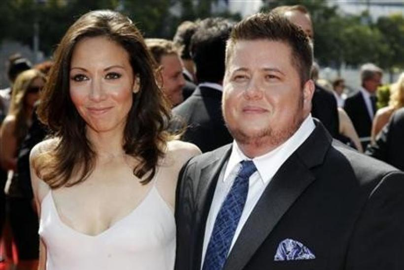 Chaz Bono (R) and Jennifer Elia arrive at the 2011 Primetime Creative Arts Emmy Awards in Los Angeles