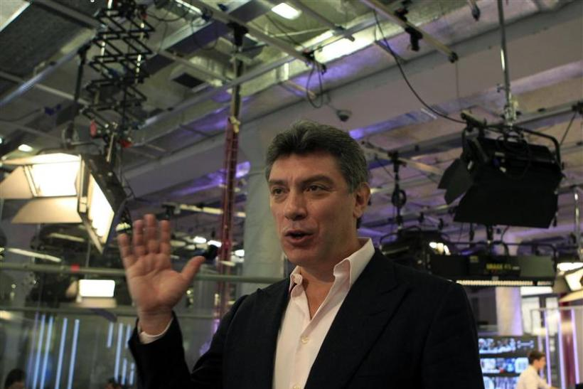 Russian opposition leader Boris Nemtsov gestures during a television interview in Moscow