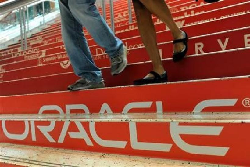 Attendees walk down branded steps at the 29th Oracle OpenWorld in San Francisco October 2, 2011.
