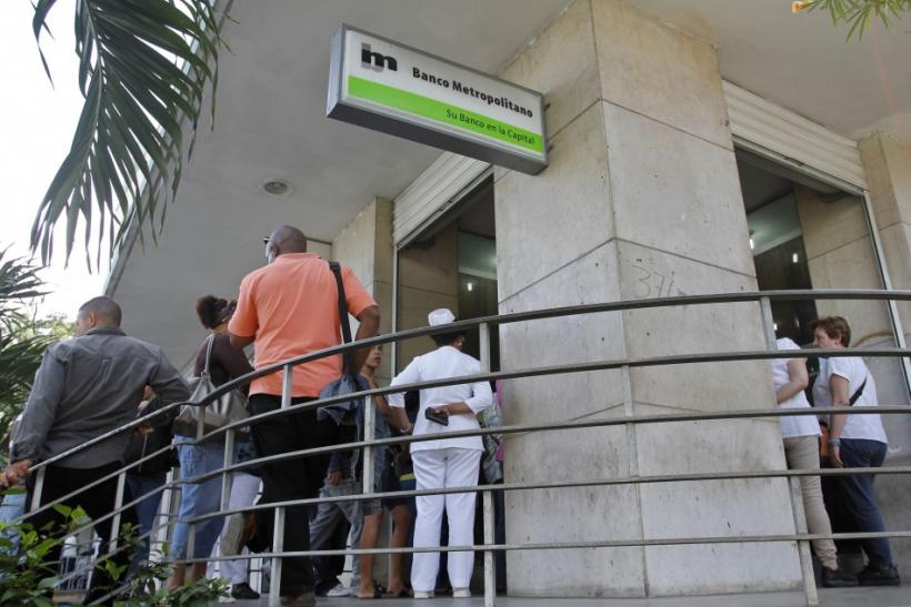 Cubans line up outside a bank in Havana