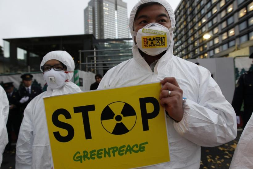 A Greenpeace activist holds a placard during a demonstration outside Japan's Prime Minister Yoshihiko Noda's official residence in Tokyo, criticizing the government's declaration of cold shutdown at the Fukushima nuclear power plant Decembe