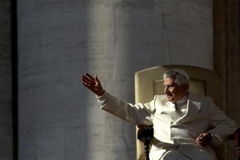 Pope Benedict XVI waves as he leads his weekly audience in Saint Peter's Square at the Vatican November 16, 2011.