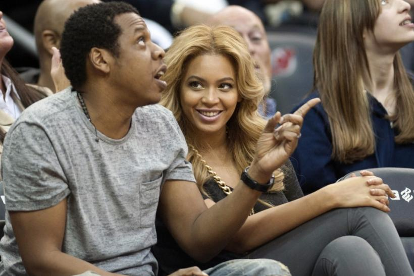 Jay Z and his wife Beyonce watch the New Jersey Nets play the Phoenix Suns in their NBA game in Newark