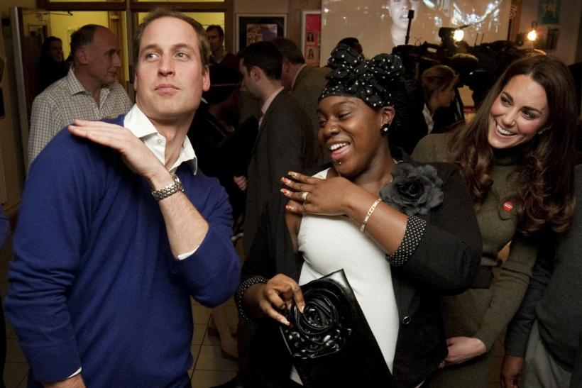 Britain's Prince William dances with Vanessa Boateng as his wife Catherine, Duchess of Cambridge looks on during a reception at Centrepoint's Camberwell Foyer in Londo
