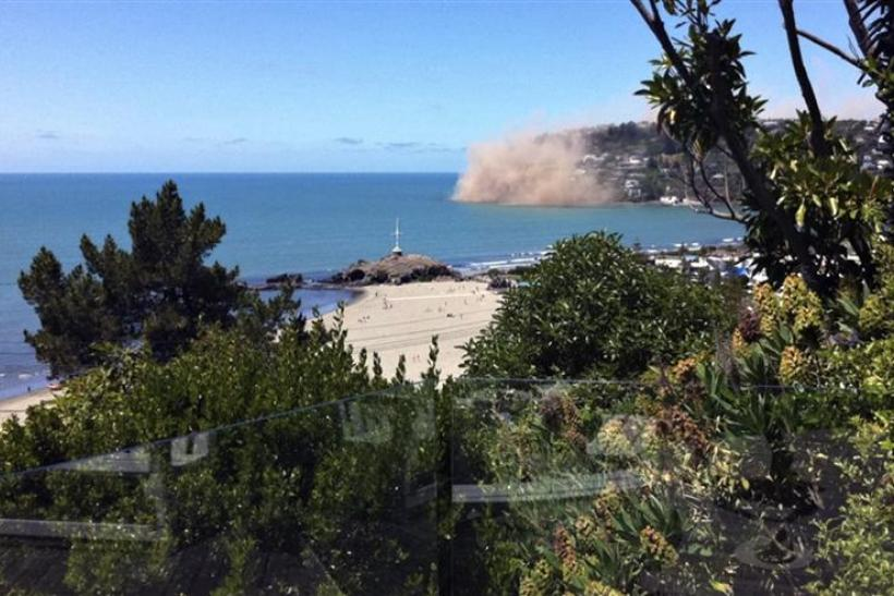 Dust rises from rocks were falling from a cliff in the Christchurch suburb of Sumner moments after an earthquake struck