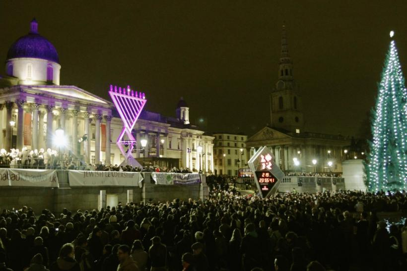 Crowds watch as a giant menorah is lit for the Jewish festival of Hanukkah in Trafalgar Square in London