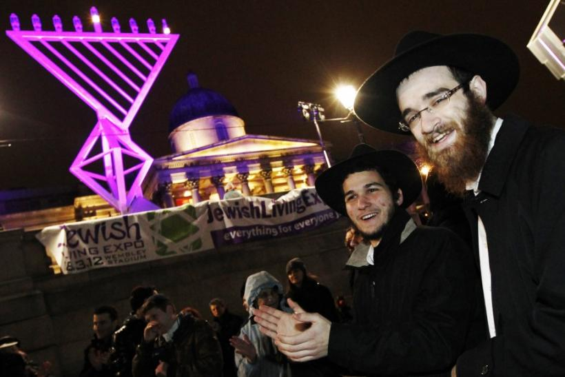 Crowd members join in for the Jewish festival of Hanukkah in Trafalgar Square in London