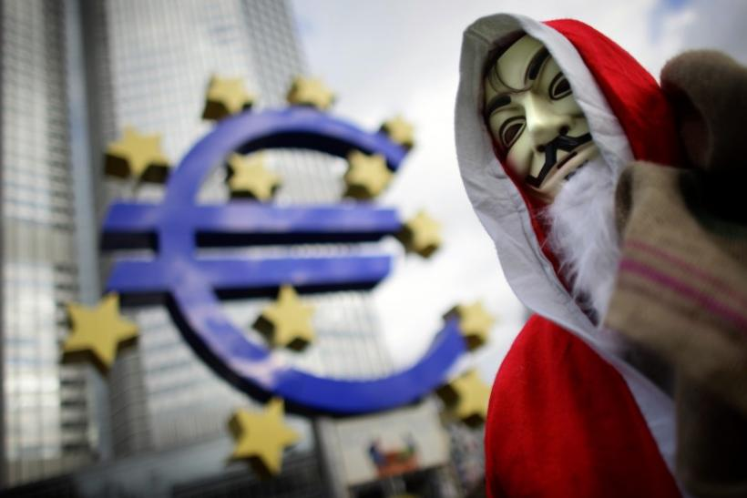 An Occupy movement protester wears a Santa Claus costume as he walks through the Occupy camp next to the euro sculpture outside the European Central Bank headquarters in the banking district of Frankfurt, Germany, on December 24, 2011.