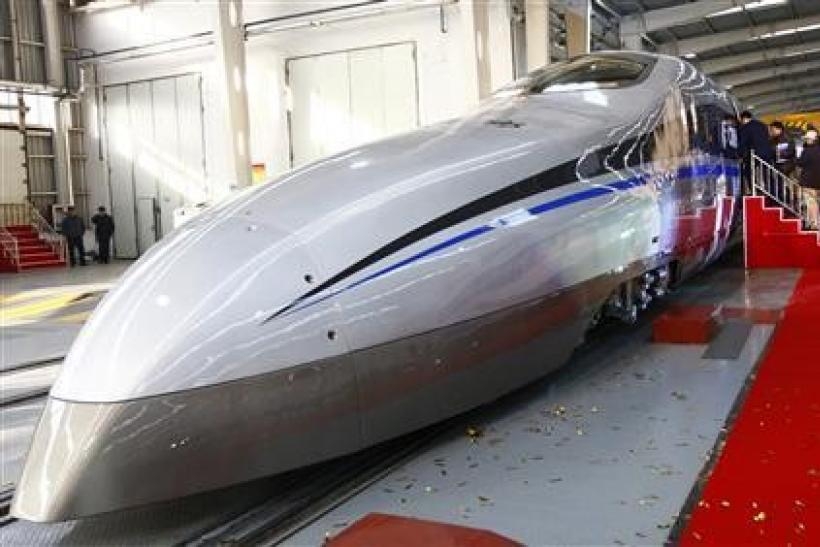 Visitors board a new testing model of a CSR high-speed bullet train during its launching ceremony in Qingdao, Shandong province December 23, 2011. China launched a super-rapid test train over the weekend which is capable of travelling 500 kilometers per h