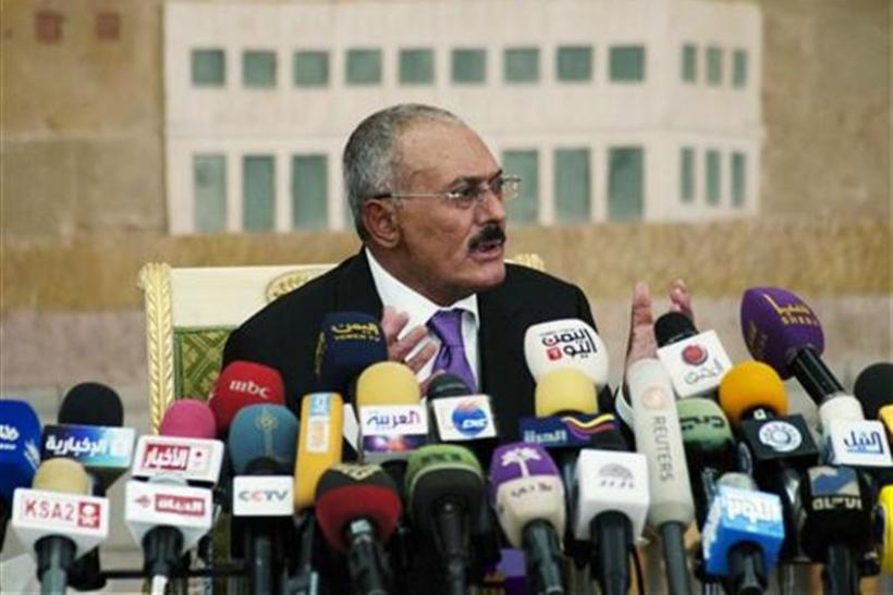 Yemen's outgoing President Ali Abdullah Saleh speaks during a news conference in Sanaa