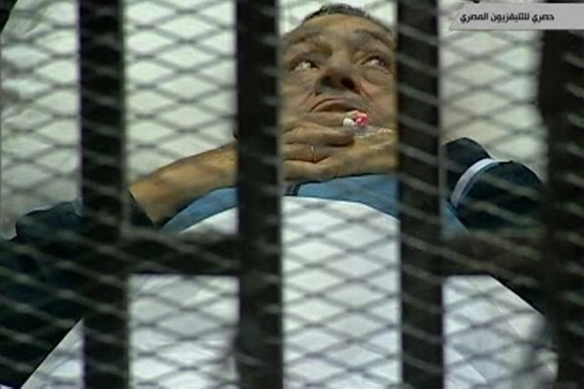 Hosni Mubarak on his caged bed in court