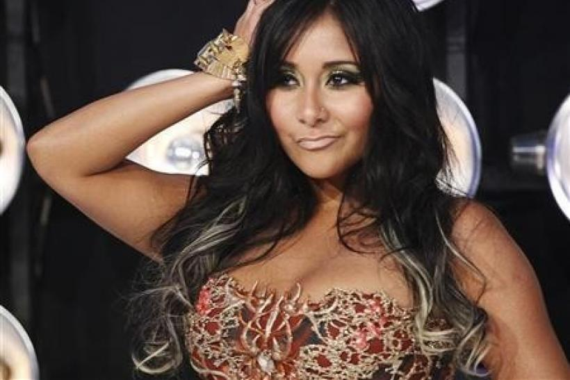 Nicole ''Snooki'' Polizzi from the MTV reality series ''Jersey Shore'' poses on arrival at the 2011 MTV Video Music Awards in Los Angeles August 28, 2011.