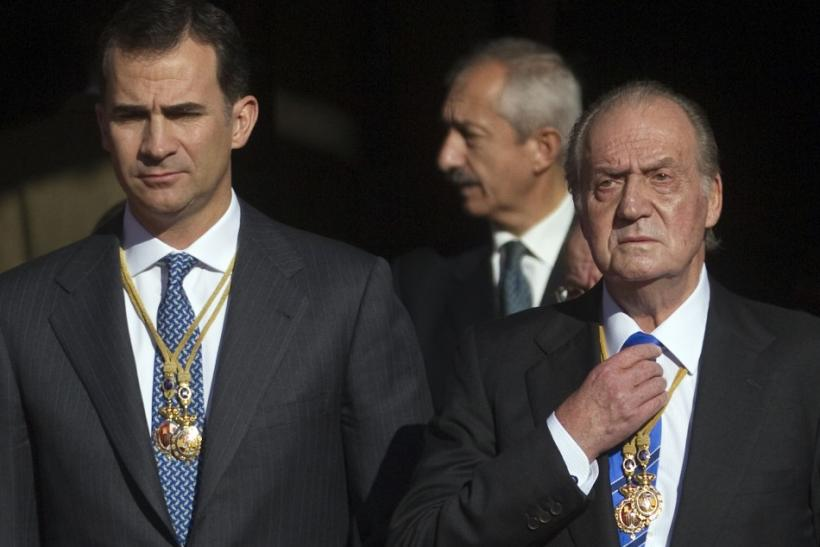 Spain's Crown Prince Felipe and Spain's King Juan Carlos watch military parade outside the Parliament in Madrid
