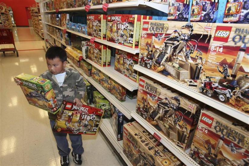 Tony Wu of San Leandro tries to choose between two Lego sets at the after-Christmas sale in San leandro
