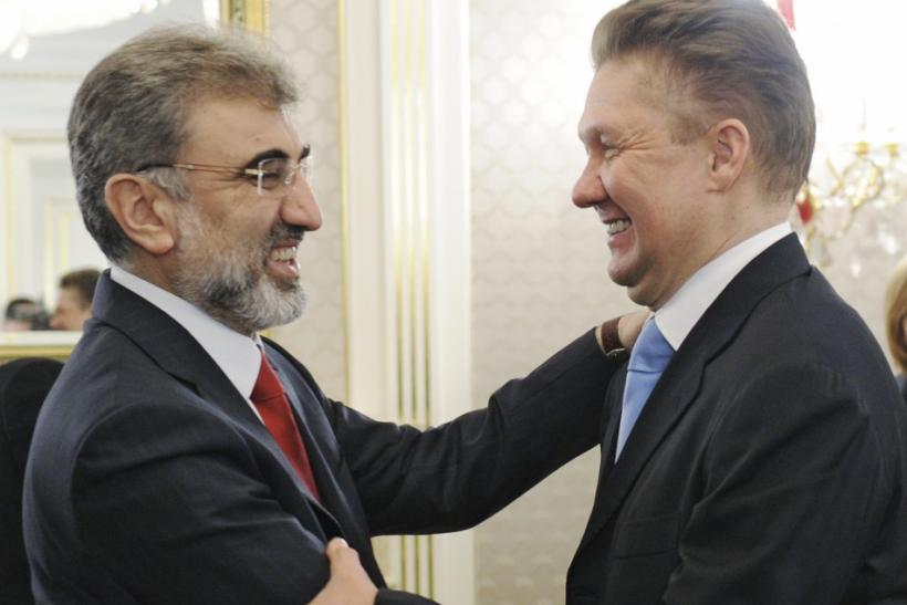 Gazprom CEO Miller greets Turkish Energy Minister Yildiz during their meeting in Moscow