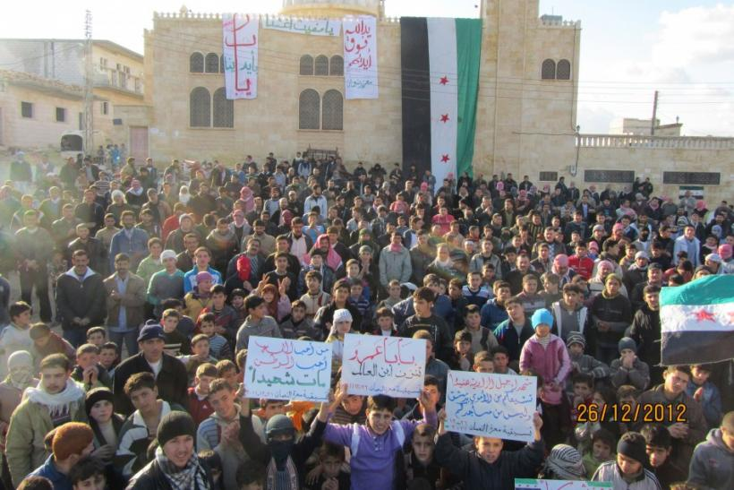 Demonstrators protest against Syrian President Bashar al-Assad in Ma'arrat al-Numan near Adlb