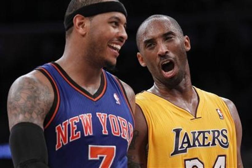 Los Angeles Lakers' Kobe Bryant (R) talks with New York Knicks' Carmelo Anthony (L) as the Lakers lead the Knicks during second half of their NBA basketball game in Los Angeles