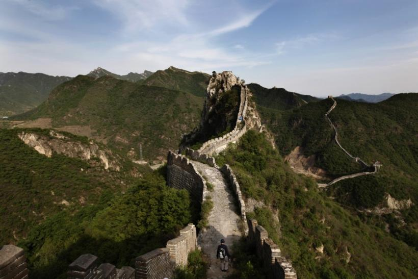 A visitor walks on the Luanling section of the Great Wall, in Huairou District