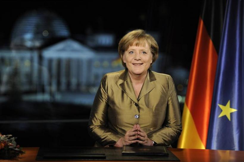 German Chancellor Merkel poses for photographs after recording of her annual New Year's speech at Chancellery in Berlin