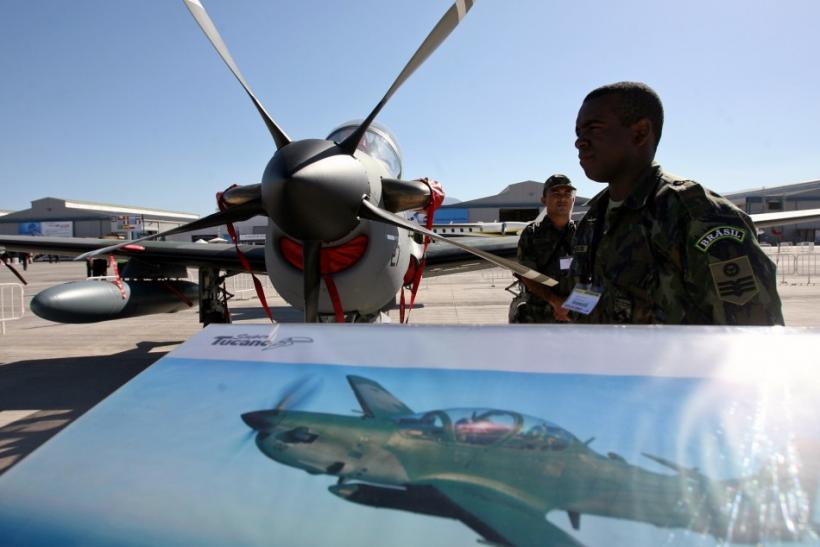 A Brazilian soldier stands guard near a A-29 Super Tucano during the opening ceremony of the Santiago Aviation Fair, known as FIDAE, at Chile's international airport on March 27, 2006.