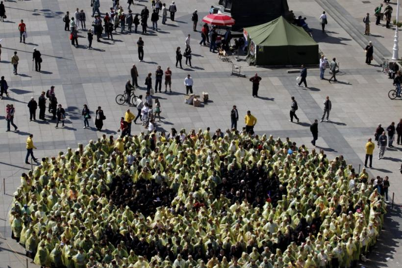 People stand together as they create the biggest human smiley in the world on the Zagreb main square