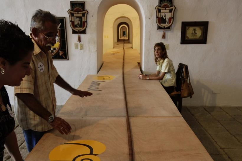 People look at the world's longest cigar in Havana