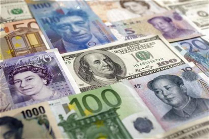 Arrangement of various world currencies including Chinese Yuan, Japanese Yen, US Dollar, Euro, British Pound, Swiss Franc and pictured in Warsaw