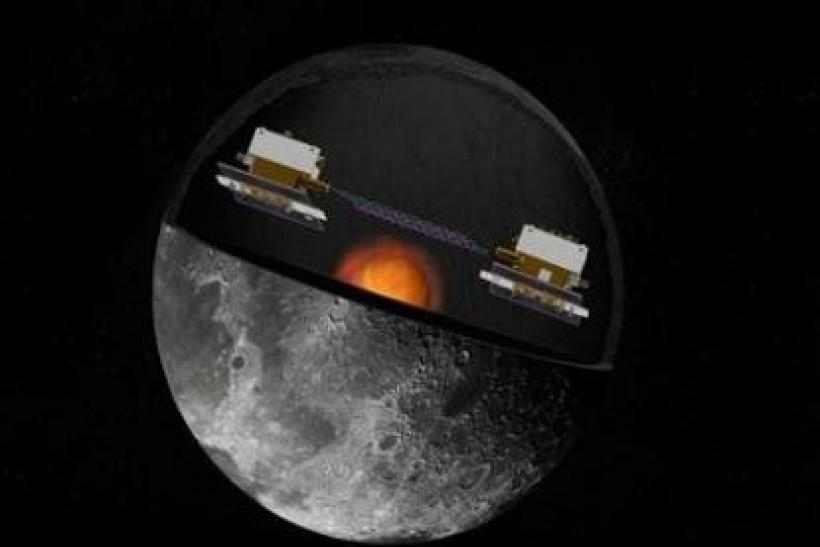 NASA handout image shows an artist's concept of the Gravity Recovery and Interior Laboratory (GRAIL) mission's twin spacecraft in orbit around the moon.