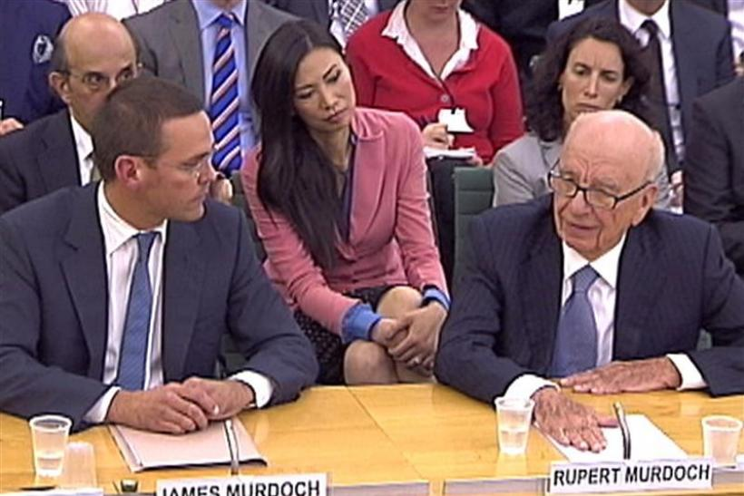 BSkyB Chairman James Murdoch, News Corp Chief Executive and Chairman Rupert Murdoch appear before a parliamentary committee at Portcullis House in London