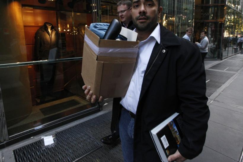 Man carries boxes after being let go