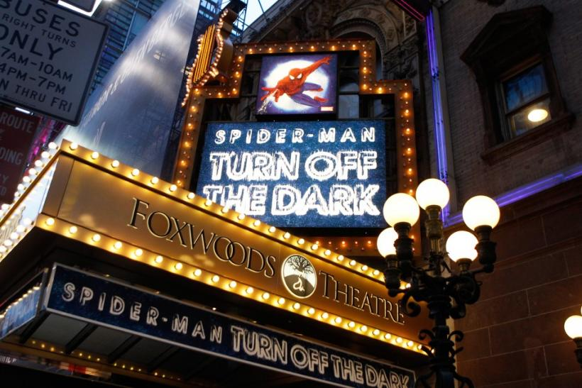 "Banners advertising the Broadway play ""Spiderman: Turn Off The Dark"" shine in front of the Foxwoods Theater in New York"