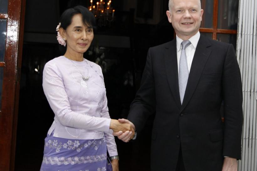 British Foreign Secretary Hague shakes hands with Myanmar pro-democracy leader Suu Kyi in Yangon