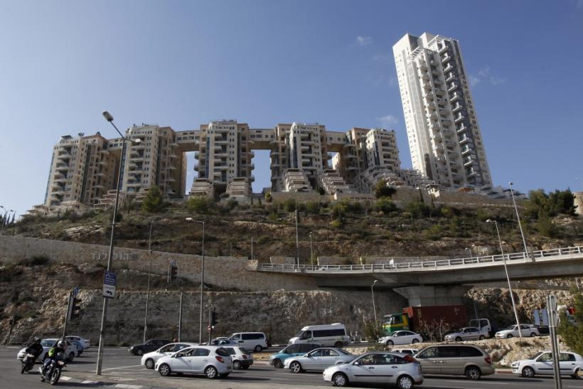 Vehicles drive past the Holyland towers apartment complex in Jerusalem