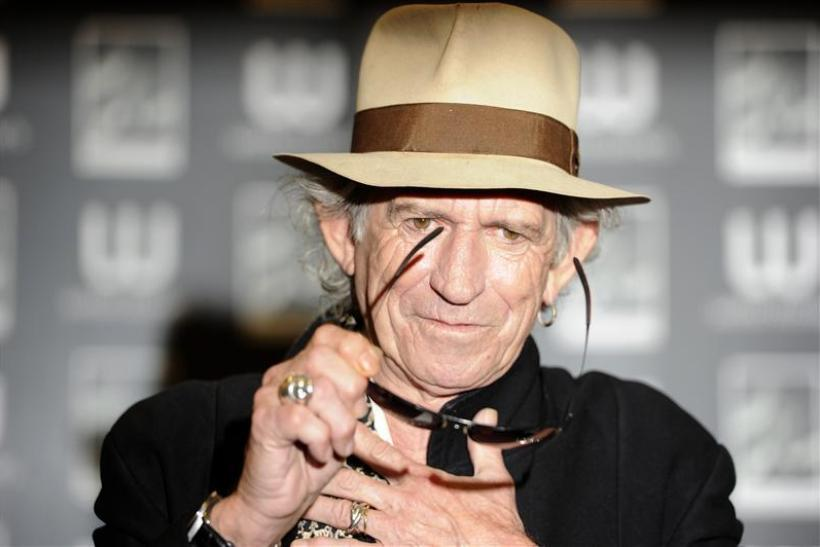 "British musician Keith Richards poses for photographers before signing copies of his autobiography ""Life"" in London"